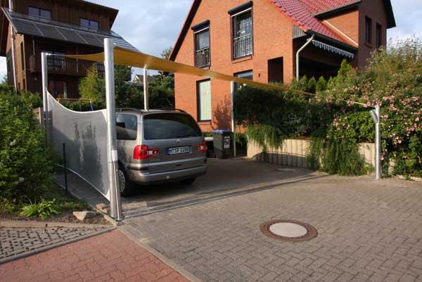 carport mit sonnensegel aus precontraint tuch und pfosten aus. Black Bedroom Furniture Sets. Home Design Ideas