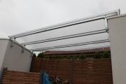 Überdachung aus Stahl mit Doppelstagplatten