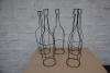 Drahtmöbel, Drahtflaschen, Prospekthalter aus Draht und ein Heizkörper aus Draht