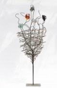 Blume aus Stahl und farbigen Glasfragmenten