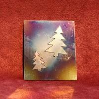 Klapp Tannenbäume aus poliertem und flammoxidiertem Edelstahl im Dreierpack