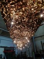 riesiges Lichtobjekt für einen Edeka Markt in Tirschenreuth aus, mit Schlagmetall versilberter Kupferfolie