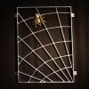 Fenstergitter als Spinnennetz mit einer Spinne aus Bronze