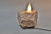 Steinleuchte aus Porphyr mit einer Windstoßkerze