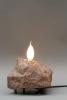 Steinleuchte, Porphyr und eine Flammstoßkerze