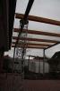Terrassendach, Überdachung aus Stahl, Glas und Holz mit Säule in Schmitzstruktur