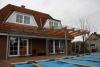 Terrassendach aus Stahl, Glas  und Leimbindern, Säule mit Schmitzstruktur