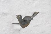 Vogel als Gardinenhalter aus gelasertem Stahl