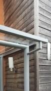 Vordach aus feuerverzinktem und lackiertem Stahl und Glas