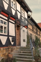 Vordach und Geländer für ein stattliches Fachwerkhaus