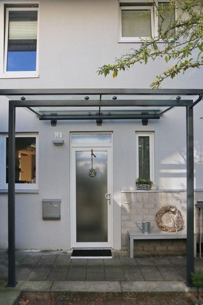 modernes vordach aus glas und stahl. Black Bedroom Furniture Sets. Home Design Ideas