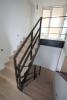 Wangenverkleidung einer Treppe aus 3mm klar lackiertem Stahlblech