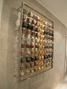 Abakus als Wandgestaltung aus verschiedenen Pflastersteinen aus Natursteinen für die Hastrabau in Langenhagen