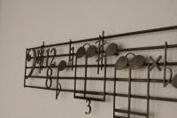 Wandrelief mit Bass Noten aus Stahlblech gelasert