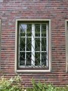 Fenstergitter mit Vogelspinne aus Bronze