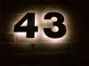 Mit LED´s hinterleuchtete Hausnummer aus Tombak