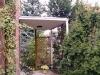 Vordach - Stahl feuerverzinkt, Stützen mit runden Steinen ummauert